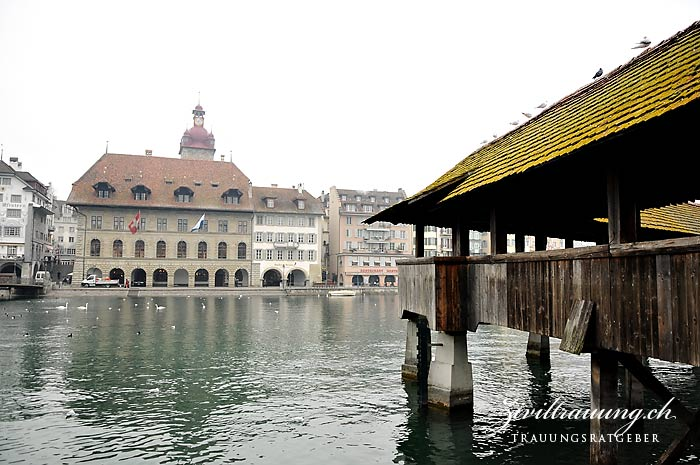 Lucerne town hall (large building with tower) as seen from the other side of the river